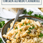 Bowl of chicken alfredo pasta with text title box at top