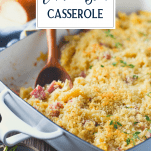 Side shot of a pan of chicken cordon bleu casserole with text title overlay