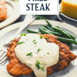 Easy chicken fried steak with gravy with a text title overlay