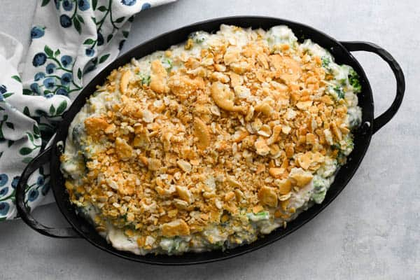Overhead shot of easy chicken and broccoli casserole in a dish with ritz cracker topping before baking
