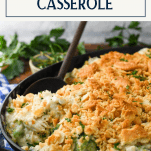 Side shot of cheesy chicken broccoli and rice casserole with text title box at top