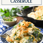 Side shot of chicken broccoli and rice casserole with ritz cracker topping and text title box at top