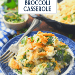 Side shot of a blue and white plate with cheesy chicken broccoli and rice casserole with text title overlay
