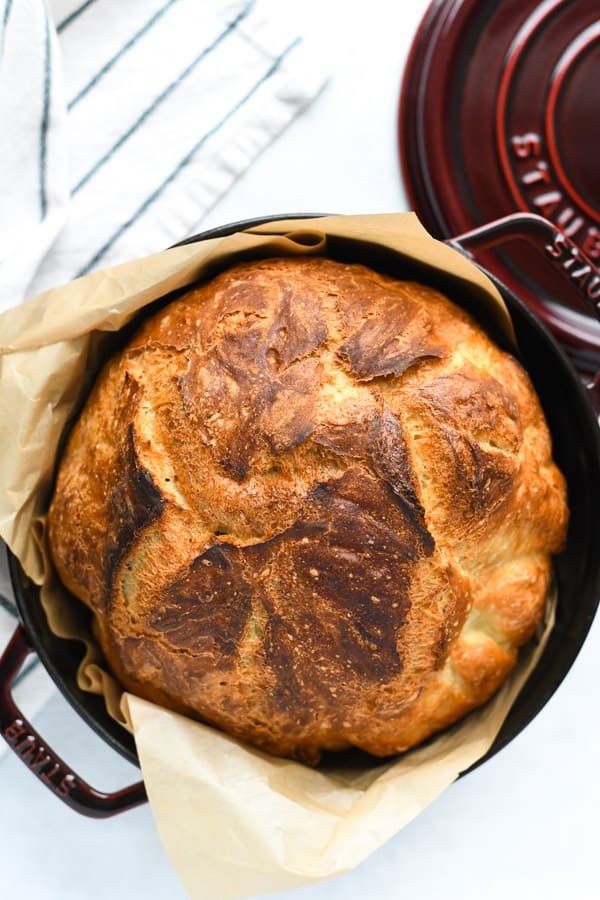 Overhead shot of Dutch oven bread on a white table