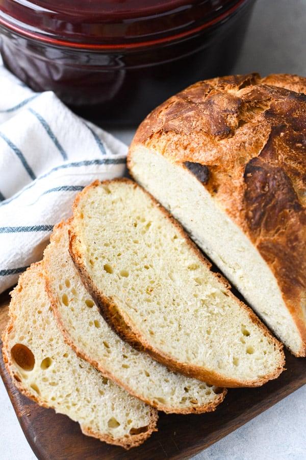 Sliced loaf of no knead bread on a cutting board