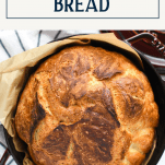 Overhead shot of easy dutch oven bread with text title box at top