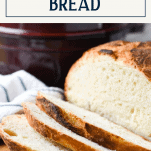 Sliced loaf of Dutch oven bread with text title box at top