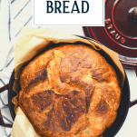 Overhead shot of no knead bread with text title overlay