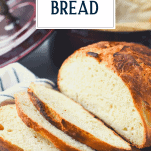 Sliced loaf of Dutch oven bread with text title overlay