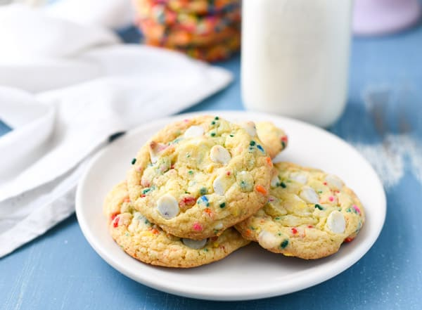Horizontal shot of a white plate full of the best funfetti cookies