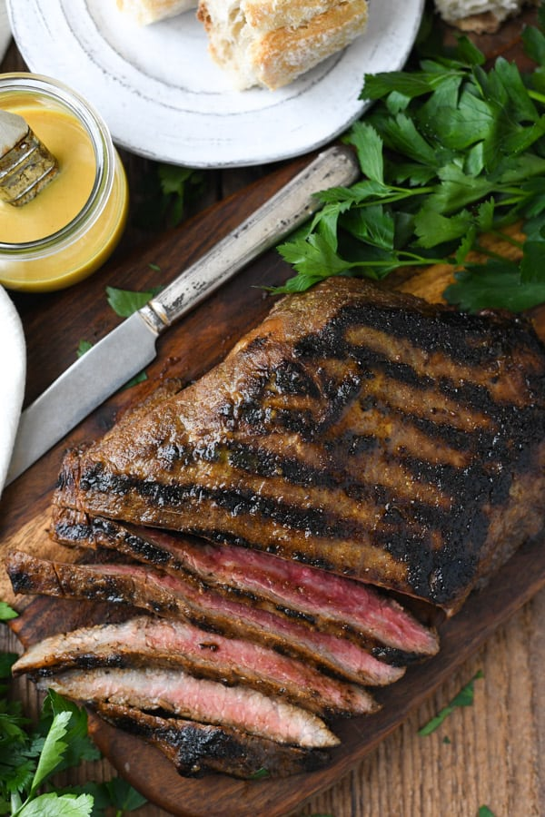 Overhead shot of sliced grilled flank steak on a cutting board