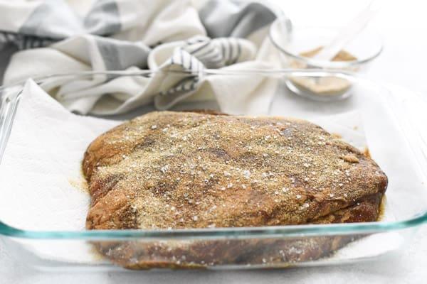 Seasoning flank steak with a dry rub