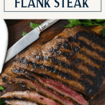 Tender and juicy flank steak on a cutting board with text title box at top