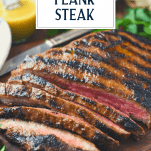 Front shot of sliced marinated grilled flank steak with text title overlay