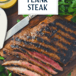 Overhead shot of sliced grilled flank steak with text title overlay
