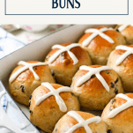 Pan of the softest hot cross buns recipe with text title box at top