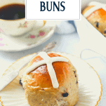 Homemade hot cross bun on a white plate with text title overlay