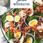 Overhead shot of a tray of spinach salad with text title overlay