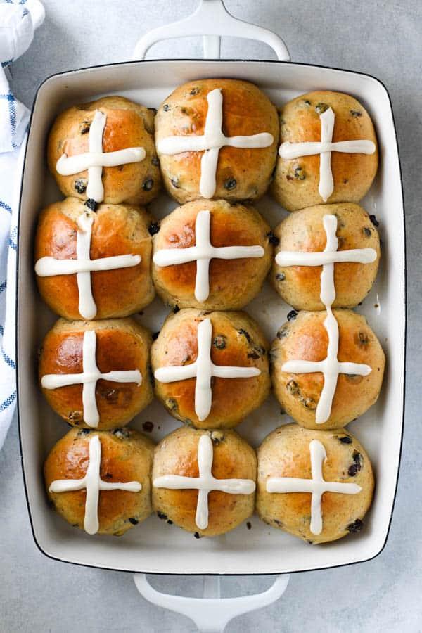 Overhead shot of a tray of homemade easy hot cross buns recipe