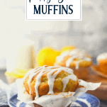 Lemon poppy seed muffins on a wooden cutting board with text title overlay