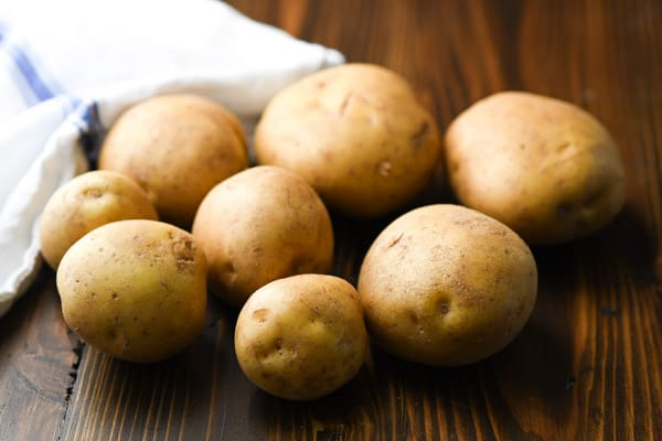 Yukon gold potatoes on a wooden table