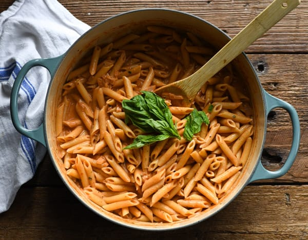 Process shot showing how to make penne alla vodka