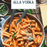 Overhead shot of a bowl of easy penne alla vodka with text title overlay