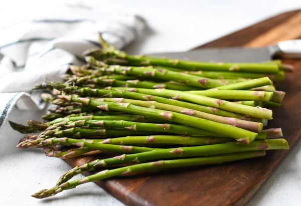 Fresh asparagus on a wooden cutting board