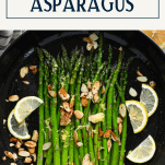 Sauteed asparagus in a cast iron skillet with text title box at top