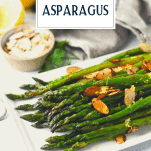 Sauteed asparagus with garlic and lemon on a white tray with text title overlay
