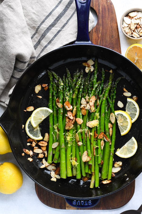 Overhead image of sauteed garlic butter asparagus in a cast iron skillet