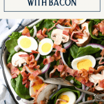 Overhead image of spinach salad with bacon and text title box over top