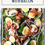 Overhead shot of spinach salad with bacon and text title box at top