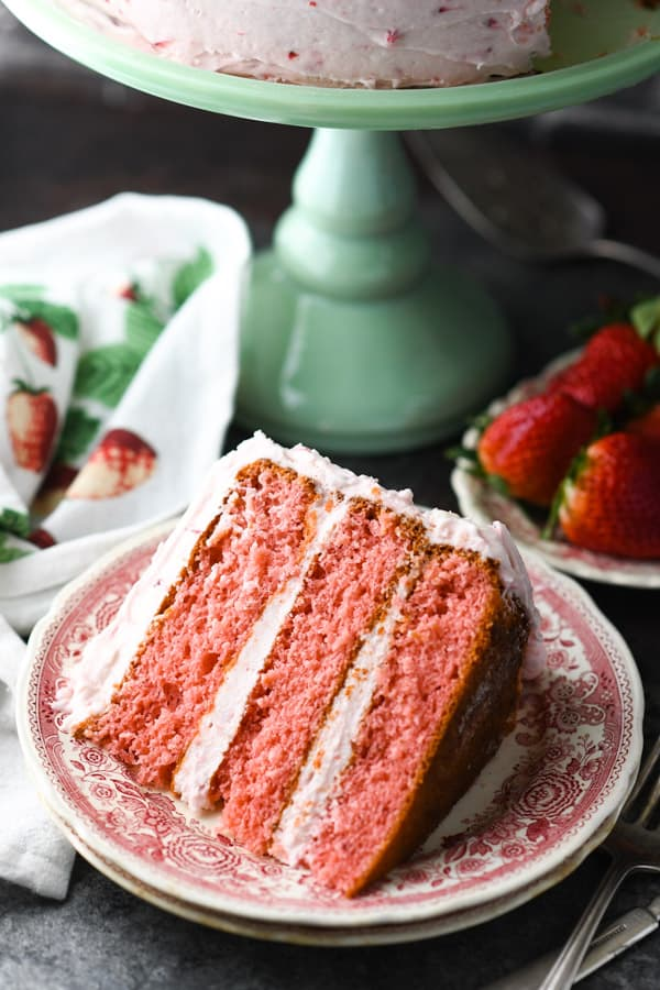 Close up front shot of a piece of moist strawberry cake recipe from box.