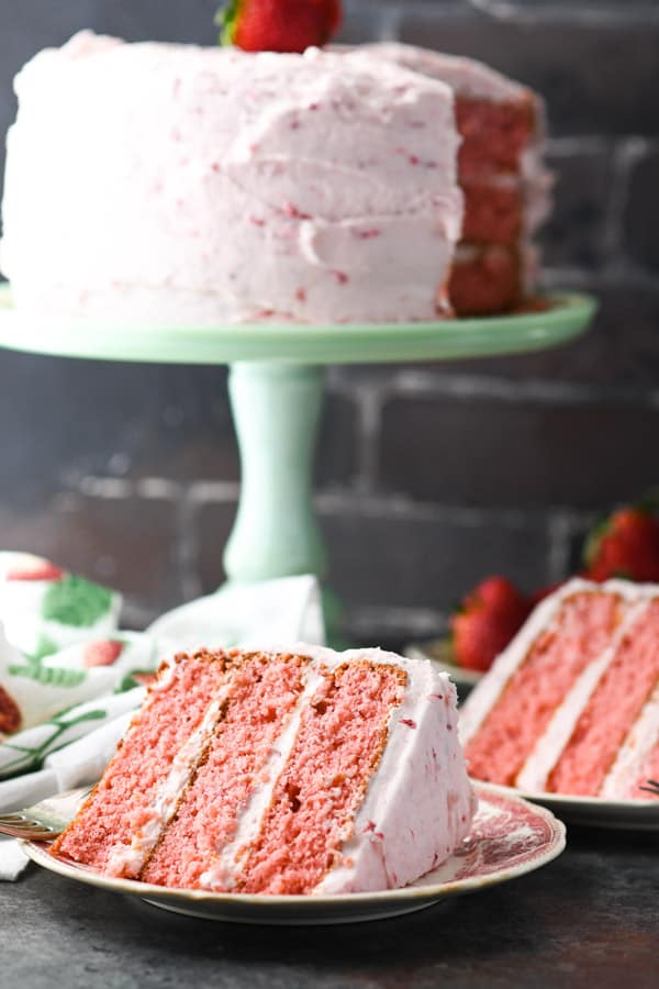 Slices of strawberry cake from scratch on individual serving plates