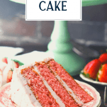 Piece of strawberry layer cake on a plate with text title overlay