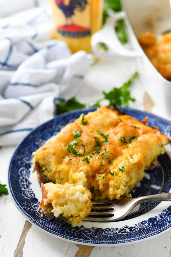 Front shot of a fork taking a bite of an easy tater tot breakfast casserole