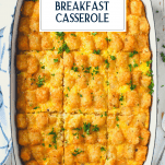 Overhead image of tater tot breakfast casserole in a white dish with text title overlay