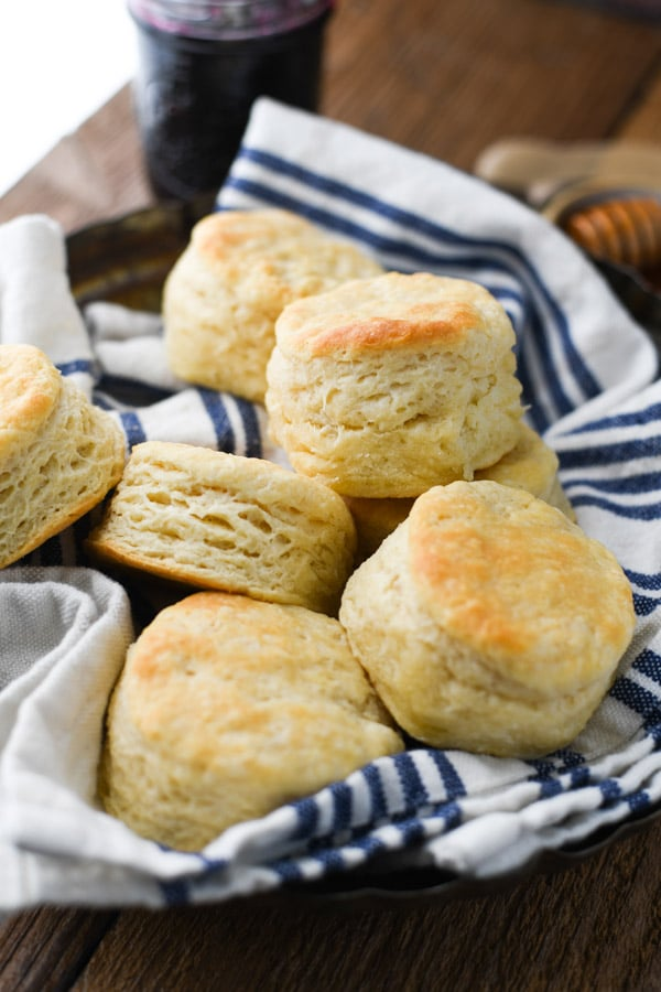 A simple 3 ingredient biscuit recipe served in a bread basket with a blue and white towel