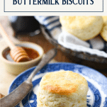 Side shot of a plate of the best buttermilk biscuit recipe with text title box at top