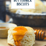 Side shot of buttermilk biscuit with honey and text title overlay