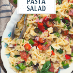 Close overhead shot of easy antipasto pasta salad recipe with text title overlay