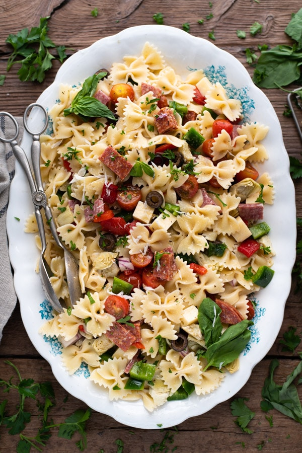 Overhead image of the best antipasto pasta salad recipe on a wooden table