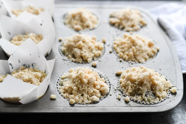 Process shot showing how to make moist blueberry streusel muffins with sour cream.