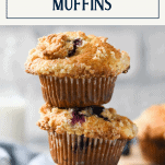 Close up shot of a stack of three blueberry streusel muffins with text title box at top