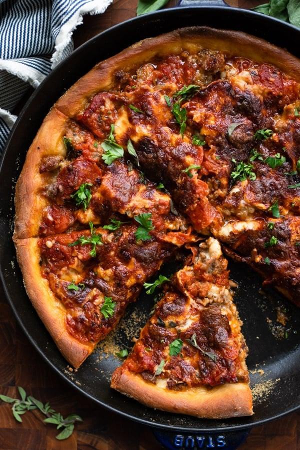 Close overhead shot of deep dish cast iron skillet pizza