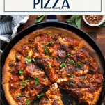 Overhead shot of deep dish pizza in a cast iron skillet with text title box at top