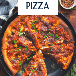 Overhead shot of cast iron skillet pizza with text title overlay