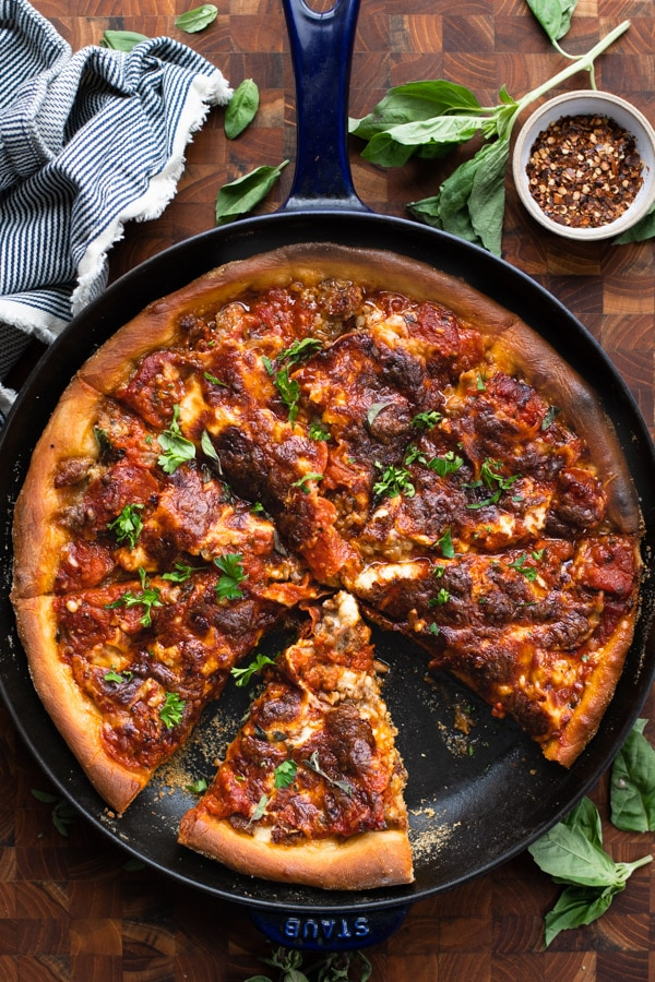 Overhead shot of deep dish pizza in a cast iron skillet