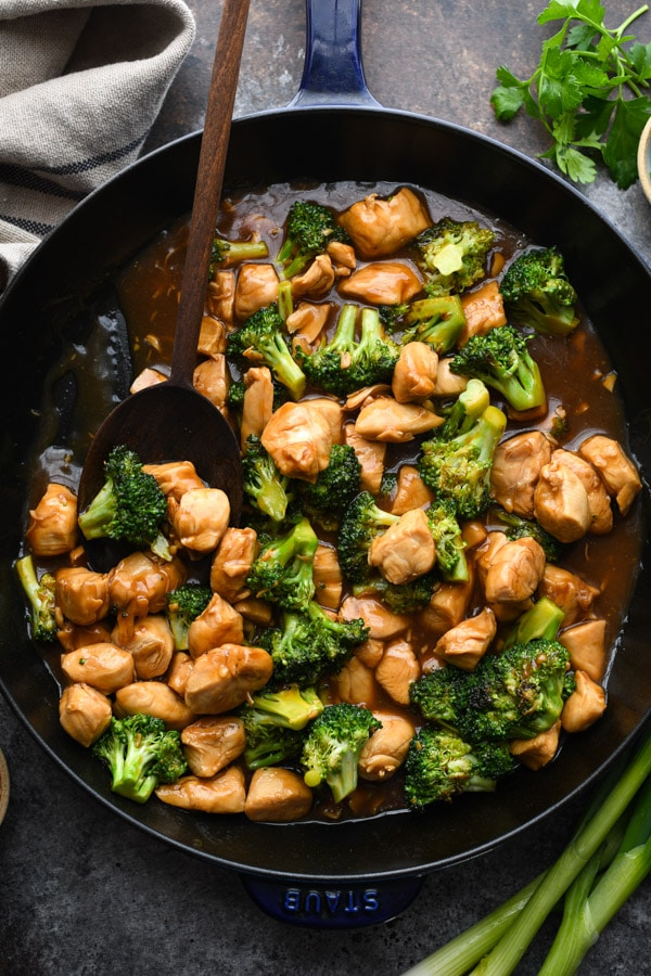 Overhead shot of chicken stir fry with broccoli in a pan
